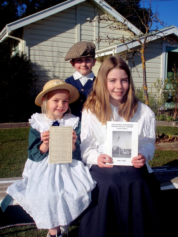 300611 News. photo supplied by Angela Woolf. Wairau Valley School students, from left, Zara Frost, Axton Miles and Ella Eberhardt in early school uniforms for the school's 150th jubilee celebrations