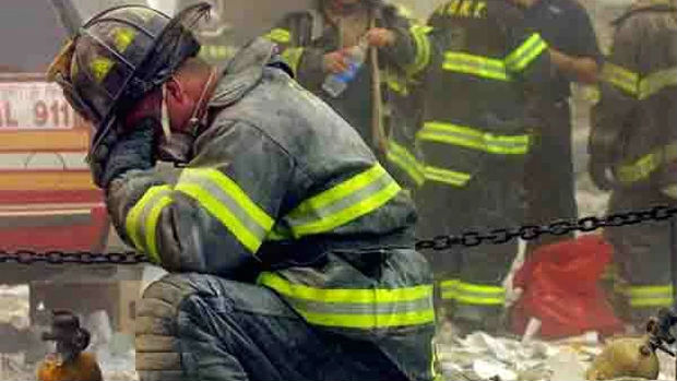a-firefighter-breaks-down-affter-the-world-trade-center-buildings-collapsed-september-11-2011